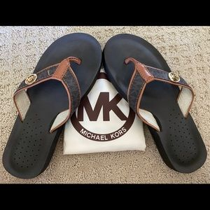 Michael Kors leather flip flops